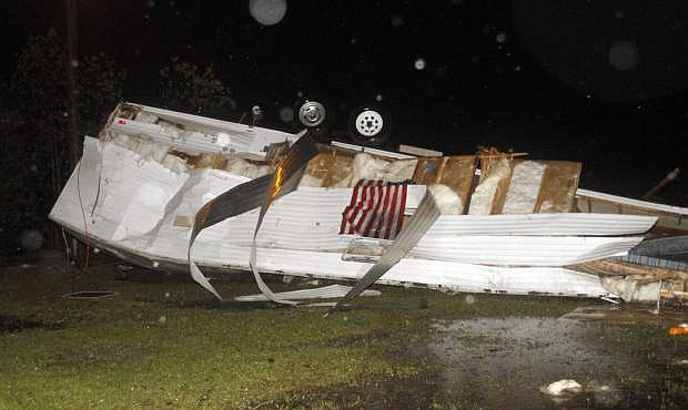 Campers at Santa Maria RV Park on Martin Bluff Road in Gautier, Miss., were flipped from possible straight line winds Monday April 14, 2014, as storms rolled over the Coast. As many as 30 campers were damaged from the storm. (AP Photo/Sun Herald, Tim Isbell)