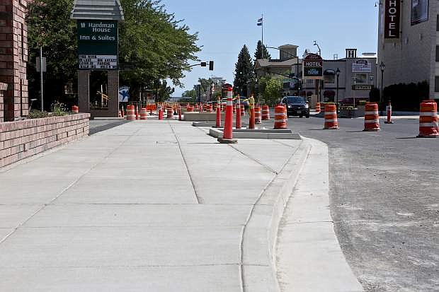 A sidewalk in its completed form is shown on the east side of Carson St. just south of William St.