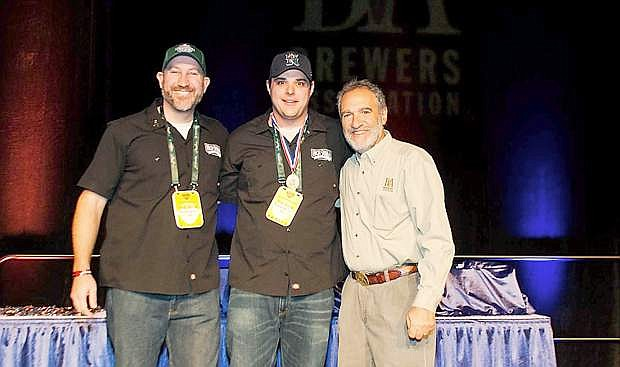 High Sierra Brewing Co. president Jim Phalan, left, and brewer  Paul Young accept a gold medal at the 2013 Great American Beer Festival.