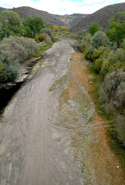 A dry Carson riverbed enters the Brunswick Canyon, seen from the Deer Run Road overpass on Tuesday.