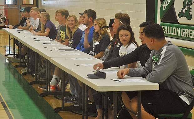 Sixteen seniors from Greenwave athletics sat for a figurative signing ceremony on Wednesday's Senior Day celebration.