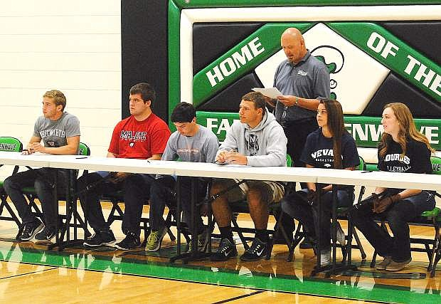 Churchill County High School Athletic Director Brad Daum reads the bios for, from left, Cameron Kissick, Cody Stadtman, Nathan Heck, Joe Pyle, Ali Tedford and Evan Matheson on Thursday at the Elmo Derrico Gym. The seniors will all compete in their sports in college next year.
