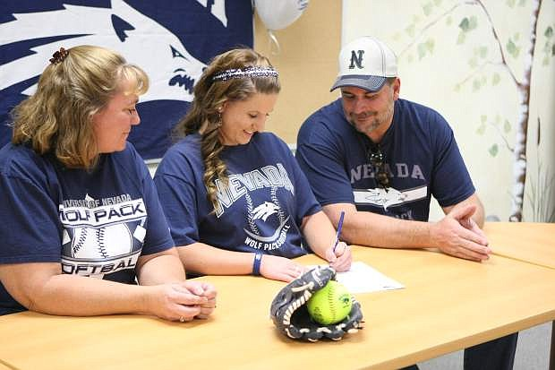 Vickie and Tom Purcell watch while Jennifer signs her letter of intent on Wednesday at Carson High School.