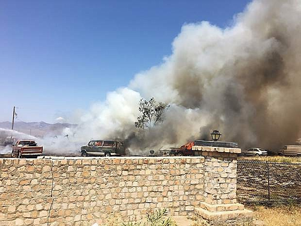 At 10:59 a.m. the Central Lyon County Fire Protection District was dispatched to 5195 Pawnee, Stagecoach, for reported multiple structures on fire.