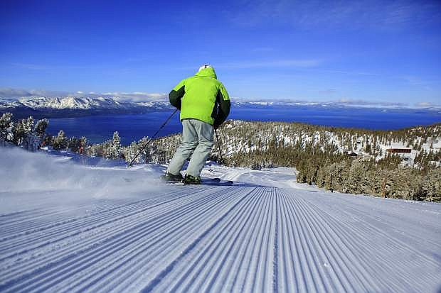 A skier cruises down a groomer at Heavenly Mountain Resort. Having a good  warmup routine can be key to helping prevent injuries.