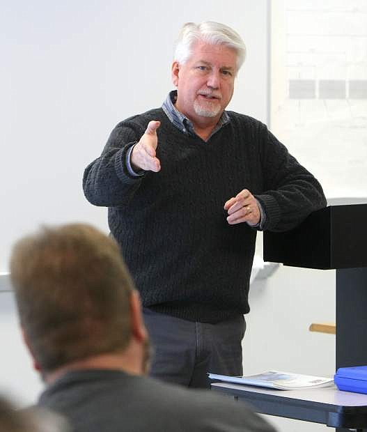 Larry Harvey with Click Bond Inc. talks with machine tool technology students on the first day of class on Monday.