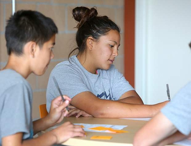 Boys and Girls Club member Natalie Ontiveros, 15, takes notes during the club's New Entrepreneurship Network on Monday.