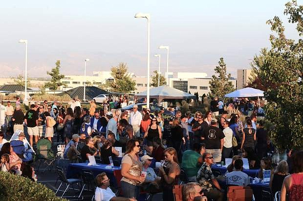 Smoke from California wildfires cover the mountains above as people enjoy Hopefest at the Carson-Tahoe Cancer Resource Center Friday night. For more photos, see page A4.