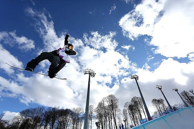 Greg Bretz of Mammoth Lakes, shown at an Olympic test event in Sochi, Russia, won the opening Olympic snowboard halfpipe qualifier.