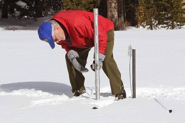 Frank Gehrke, chief of the California Cooperative Snow Surveys program, measures the snowpack at Phillips Station Wednesday, Dec. 30.