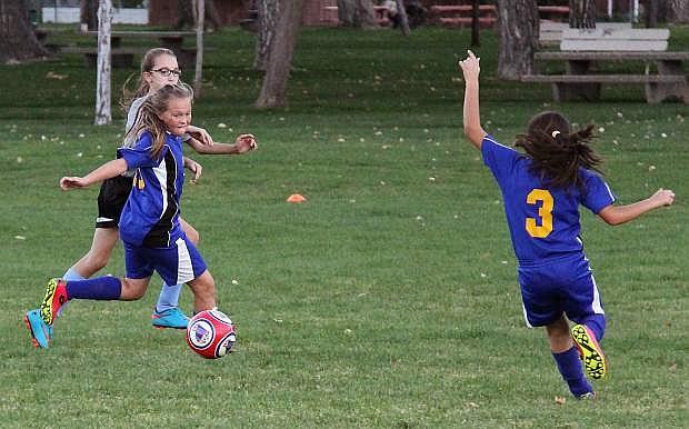 Carson Futbol Club U12 girls Boom team scrimmages in Mills Park in Carson City, Nev., in Oct. 2015.