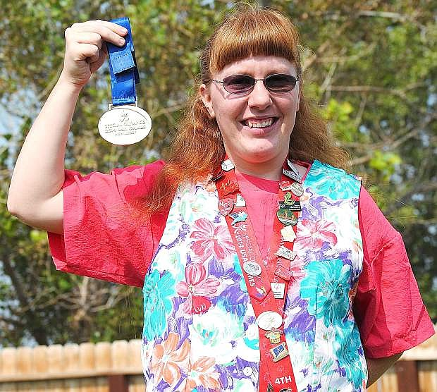 Fallon's Brandy Goodson shows off her gold medal in the 100-meter race from the 2014 Special Olympics held in Princeton, N.J. in June.