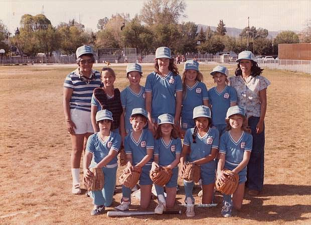 Jean McNicoll, left, and Myrna Rivera with the 1983 Carson City Bobby Sox team they coached. The sisters are organizing a reunion of female athletes from the 60s-80s.