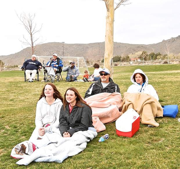 Despite spring's cool start at 3:45 p.m. WNC Softball fans Kristalei Wolfe and Carlie, Mike and M'lisa Callahan sit under blankets and enjoy the game Friday afternoon at the Edmonds Sports Complex. The Callahan's daughter Kelsie is a first baseman for the Wildcats.