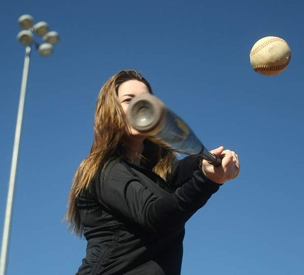 Carson City resident Kennedy Ogle takes advantage of a warm bluebird day to hit some baseballs at Governors Field on Monday.
