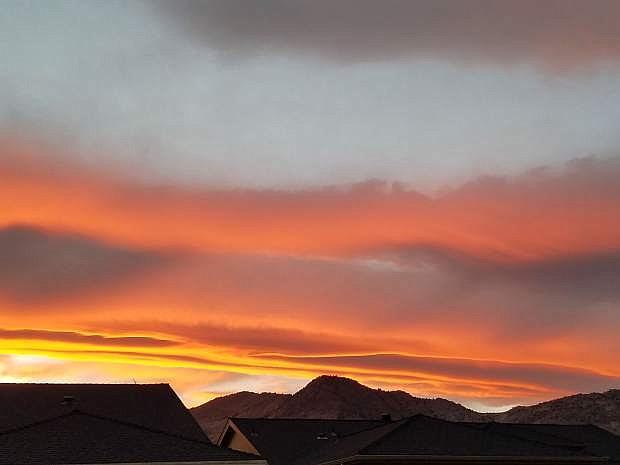 An autumn sky is illuminated over Dayton. Photo by Nancy Sawyer.
