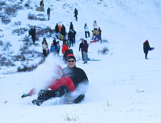 Andrew Lin, 14, and his brother Kevin, 18, from San Francisco enjoy some sledding on Spooner Summit Saturday afternoon.