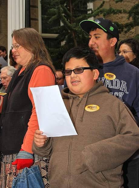 Matthew Barragen, 11, sings 'Home Means Nevada' on the steps of the Capitol building Thursday morning.