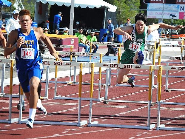 Fallon senior Nathan Heck, right, attempts to chase down Moapa Valley's RJ Hubert during the 110-meter hurdles during Friday's Division I-A state track meet in Las Vegas. Heck placed second.