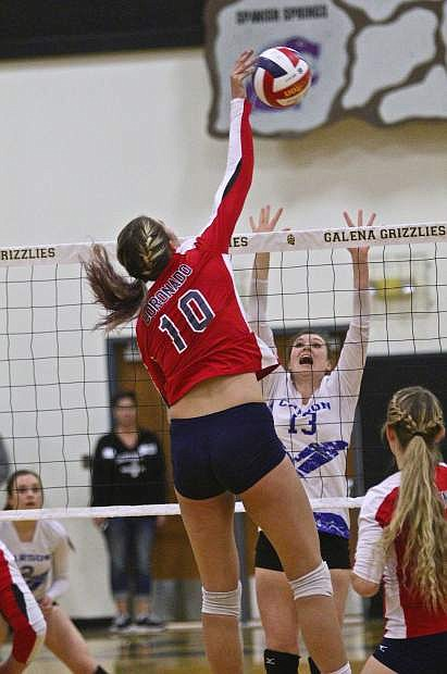 "6' 4"" Coronado senior Berkeley Oblad (10) hammers one past Carson's Keelin Pilgrim Friday night at the State Tournament."