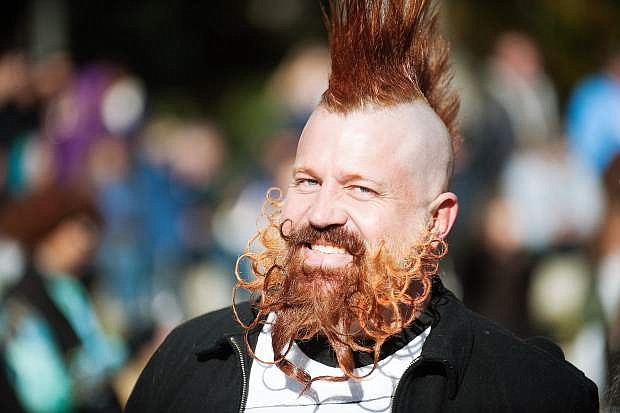 Mike Powell, winner of the Best Groomed category watches other contestants during the Nevada Day Beard Contest on Saturday, Nov. 1, 2014 in Carson City.