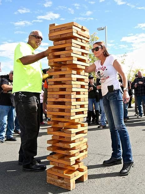 Mike Hamilton of Manhattan Beach, Ca. and Kristina Presher of South Lake Tahoe play a game of 'Tahoe Tony's Jammin' Jerky Giant Jenga' Friday at Battle Born Harley Davidson.