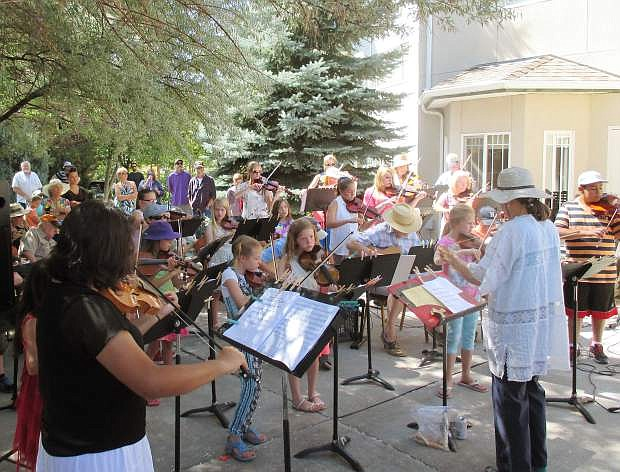 Sue Jesch conducts a Strings in the Summer performance last year.