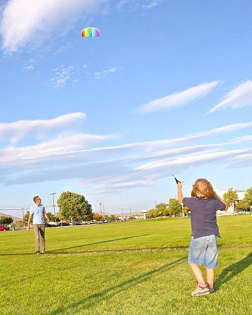 Blustery winds Wednesday evening made for perfect stunt-kite flying weather at Mills Park for Big Brothers Big Sisters volunteer David Folkner of Gardnerville and 'little brother' Garrett Burton-Abbott, 8, of Carson City.