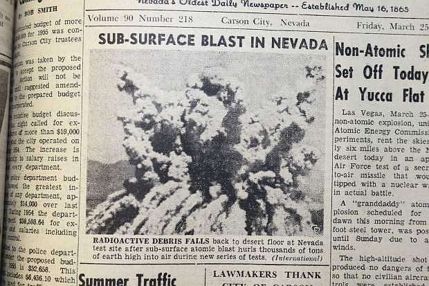 March 25, 1955: Radioactive debris falls back to desert floor at Nevada test site after sub-surface atomic blast hurls thousands of tons of earth high into air during new series of tests. (International)