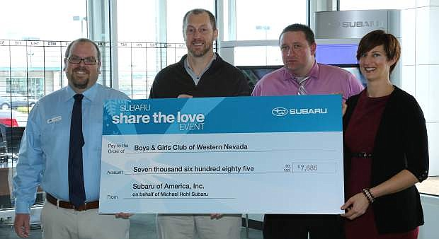 Katie Leao, executive director for the Boys & Girls Clubs of Western Nevada is presented a check for $7,685 from Subaru representatives, from left, Nick Reinhardt, sales manager; Shawn Bachelder, district sales manager; and Bryan Worch, general sales manager.