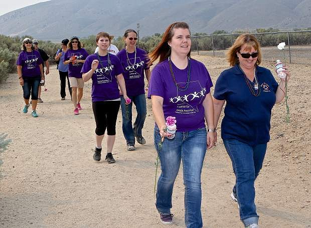 Lindsey McElfish of Carson City and Debbie Walker of Douglas County lead a group of Suicide Awareness walkers at Riverview Park Saturday morning in Carson. They were walking for Veterans and family friends with  approximately 60 other participants.