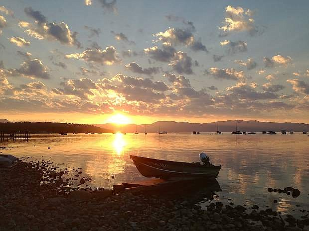 The sun rises over Lake Tahoe, as seen from Commons Beach in Tahoe City on Aug. 10. The 2015 Lake Tahoe Environmental Summit in Zephyr Cove will cover a variety of issues pertaining to Lake Tahoe on Monday, Aug. 24.