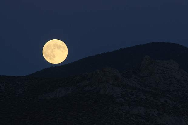 A Supermoon rises over south Carson City on Monday night.
