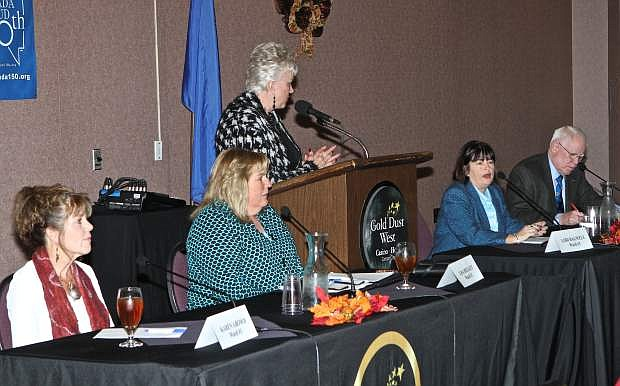Ronni Hannaman, center, Carson City Area Chamber of Commerce Executive Director leads a supervisor candidate question and answer session at 'Soups On' at the Gold Dust West Casino Wednesday afternoon.