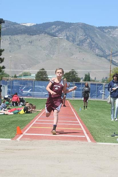 Annalucia Kinder of Carson Middle School competes in the high jump during the Tah-Neva Championships on Wednesday.