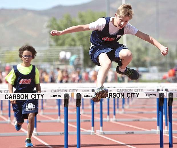Eagle Valley's William Ore clears a hurdle in the 7th grade 80-meter event at the Tah-Neva Championships Wednesday at Carson High School.