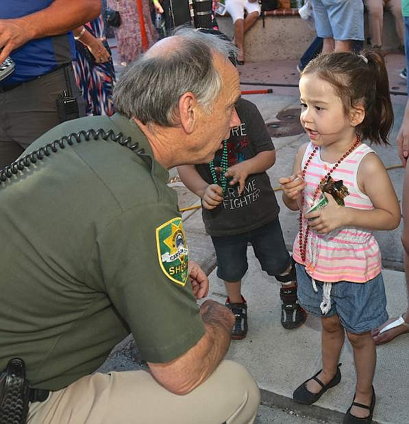 Sheriff Ken Furlong has a little talk with 5-year-old Marina Sapolu Saturday night.