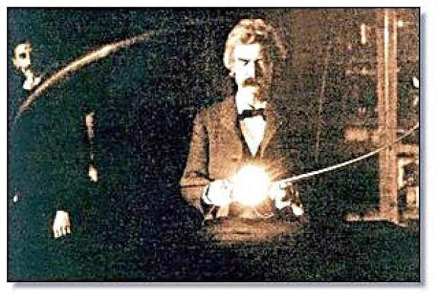 In this historic photo from 1894, Mark Twain experiments with an invention in Nikola Tesla's lab. Tesla can be seen in the background.
