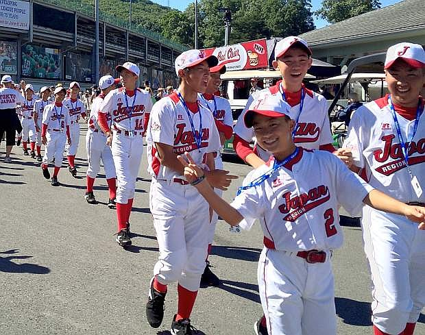 The Japan team walks into the opening ceremonies of the Little League World Series.