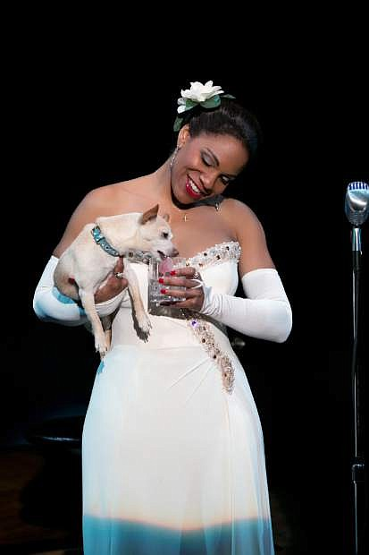 """FILE - This file photo provided by Jeffrey Richards Associates shows Audra McDonald as Billie Holiday in """"Lady Day at Emerson's Bar & Grill."""" McDonald on Tuesday, April 29, 2014 earned a Tony nomination for """"Lady Day at Emerson's Bar & Grill,"""" meaning she is in a position to make history as the Tonys' first grand-slam performance winner. (AP Photo/Jeffrey Richards Associates, Evgenia Eliseeva, File)"""