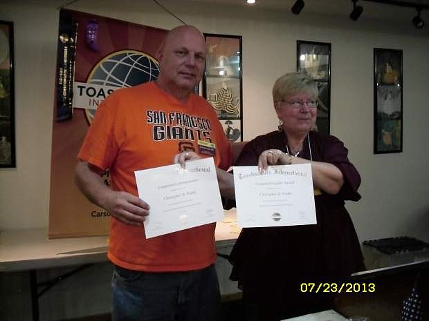 Cathy French, president of Toastmasters Club 1813, presented Chris Wahle with the Competent Communicator & Competent Leadership Award July 23.