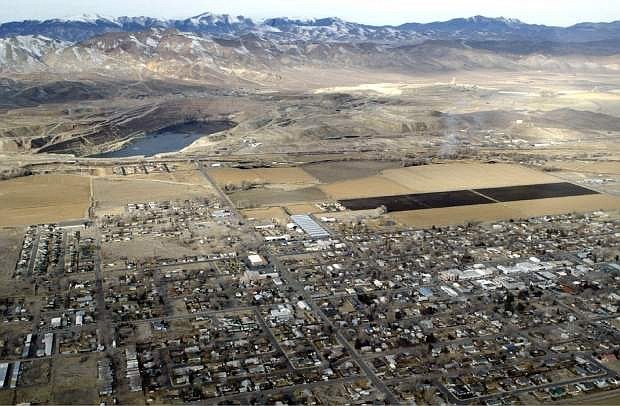 The Yerington mine site, adjacent to the small farming town of Yerington, Nev. Rural neighbors of an abandoned World War II-era copper mine that has leaked toxic chemicals in Northern Nevada for decades have won up to a $19.5 million settlement from companies they accused of covering up the contamination, according to a report.