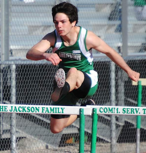 Fallon junior Nathan Heck clears a hurdle during the first meet of the season. The Greenwave host the 42nd annual Fallon-Elks Invitational at 9 a.m. Saturday at the Edward Arciniega Complex.