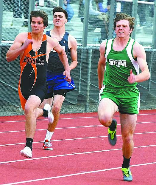 Jake Ernst sprints past the field in a preliminary heat of the 100-meter race on Saturday.