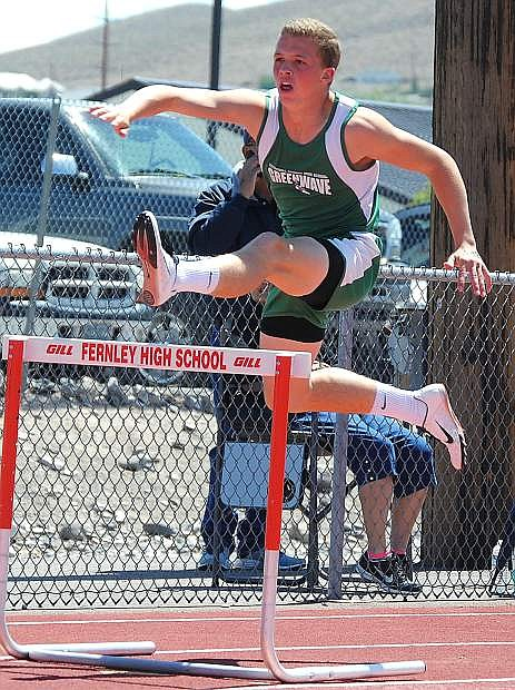 Jordan Schultz clears a hurdle during the 300-meter event at Saturday's regional meet in Fernley.