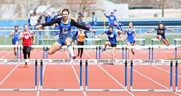 Carson's Athena Favero runs the 300 hurdles during a recent meet.