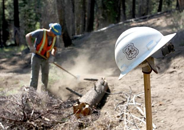 Jacob Quinn, a trails engineer with the U.S. Forest Service, works on a trail system off Tahoe Mountain Road on Wednesday.