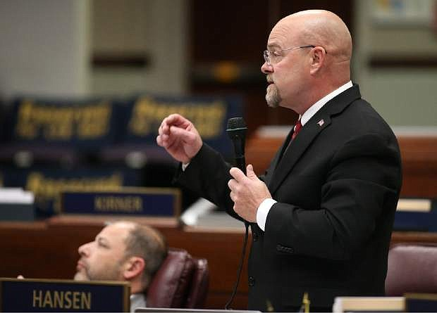 In this April 21, 2015, photo, Nevada Assemblyman Ira Hansen, R-Sparks, speaks during Assembly floor debate about a bill that would require transgender students to use school facilities based on their biological gender, in Carson City, Nev., on Tuesday, April 21, 2015. The Nevada Assembly rejected the bill that outraged transgender advocates. (AP Photo/Cathleen Allison)