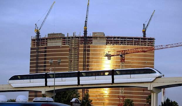 The  Las Vegas Monorail passes the under-construction Wynn Las Vegas hotel and casino in Las Vegas. Transportation leaders in southern Nevada who are considering multiple changes that could cost $7 billion to $12 billion to make it easier for visitors to get around the gambling destination.