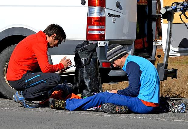 In this Dec. 27, 2014 photo, Kevin Jorgeson, 30, of Santa Rosa, Calif., left, and Tommy Caldwell, 36, of Estes Park, Colo., prepare their climbing gear before beginning what has been called the hardest rock climb in the world: a free climb of a El Capitan, the largest monolith of granite in the world, a half-mile section of exposed granite in California's Yosemite National Park. Tom Evans, a climber and photographer, has been chronicling Jorgeson and Caldwell, as they scale their way using only their hands and feet. (AP Photo/Tom Evans, elcapreport)